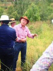 Paul MacDonald leading the site visit through Brown Snake country